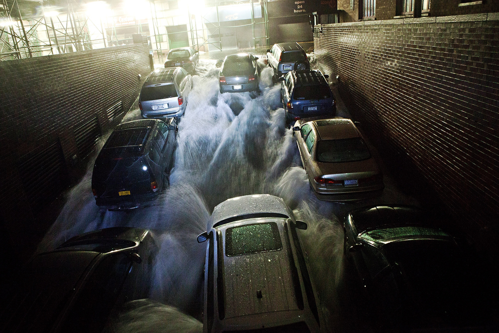Description of . Rising water, caused by Hurricane Sandy,  rushes into a subterranian parking garage on October 29, 2012, in the Financial District of New York, United States. Hurricane Sandy, which threatens 50 million people in the eastern third of the U.S., is expected to bring days of rain, high winds and possibly heavy snow. New York Governor Andrew Cuomo announced the closure of all New York City will bus, subway and commuter rail service as of Sunday evening  (Photo by Andrew Burton/Getty Images)