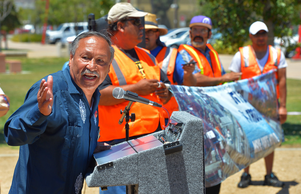 . United Farm Workers President Arturo Rodriguez thows in his support of striking truckers at a press conference in Wilmington, CA on Monday, July 7, 2014. United Farm Workers joined Teamsters as they picketed several trucking companies and shipping terminals at the ports of Long Beach and Los Angeles. (Photo by Scott Varley, Daily Breeze)