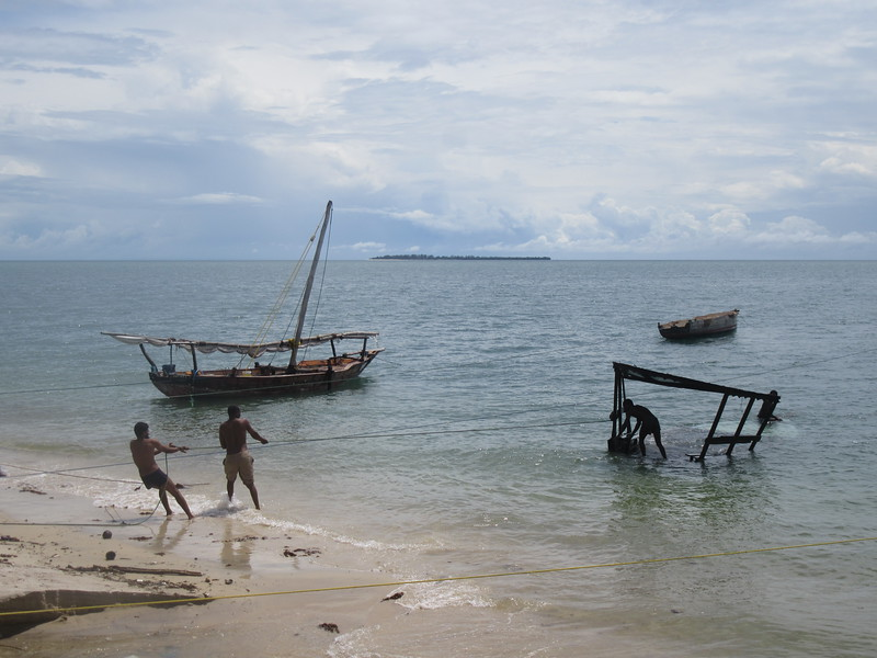 013_Fishing Dhow. Rainy season and high tide has sunk the boat.JPG