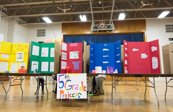 03/27/18 Wesley Bunnell | Staff A first grade class gathers on the opposite side of the 5th grade projects section at the Smalley Academy 2nd Annual Smalley Science Fair on Tuesday morning featuring science exhibits by different grades.
