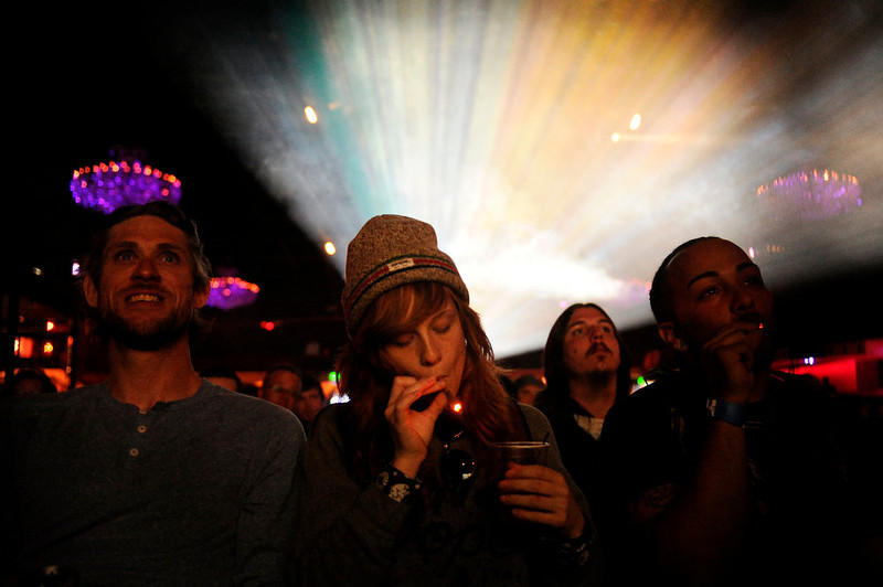 """. Caiti Beckwith of Denver, smokes a joint while watching the Snoop Lion documentary Reincarnated on Friday, April 19, 2013 at the Fillmore Auditorium in Denver during the first ever \""""Green Carpet\"""" event as a part of the High Times Cannabis Cup. Seth A. McConnell, The Denver Post"""