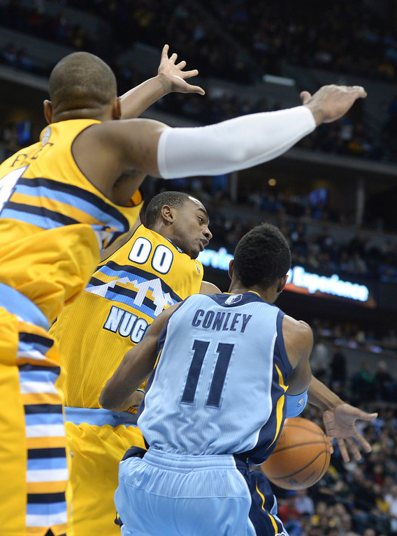 . DENVER, CO. - JANUARY 03:  Memphis guard Mike Conley (11) tried to get a pass past Denver forward Darrell Arthur (00) in the second half. The Denver Nuggets broke an eight-game losing streak with a 111-108 win over the Memphis Grizzlies at the Pepsi Center Friday night, January 3, 2014. Photo By Karl Gehring/The Denver Post
