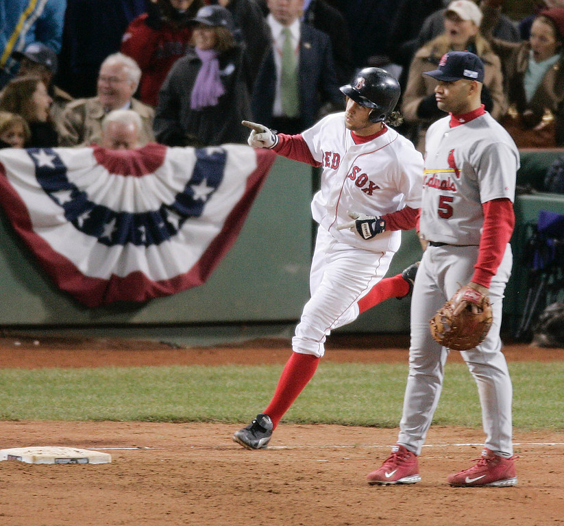. St. Louis Cardinals first baseman Alert Pujols, right, watches as Boston Red Sox\'  Mark Bellhorn rounds first base after his two-run dinger in the eighth inning of Game 1 of the World Series Saturday, Oct. 23, 2004 in Boston. (AP Photo/Amy Sancetta)