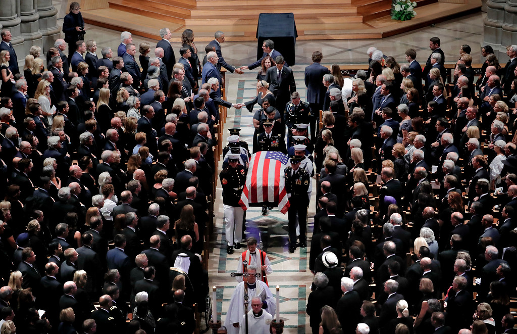 . The family of Sen. John McCain, R-Ariz., follows as his casket is carried at the end of a memorial service at Washington National Cathedral in Washington, Saturday, Sept. 1, 2018. McCain died Aug. 25, from brain cancer at age 81. (AP Photo/Pablo Martinez Monsivais)
