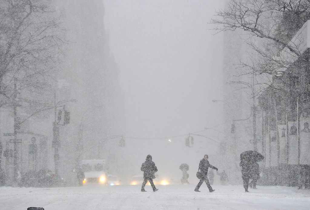 . A view down 5th Avenue in the snow as New Yorkers get hit with a  winter storm in the Northeast January 21, 2014  that could bring up to a foot (30 cm) of snow in the city.  AFP PHOTO / TIMOTHY A. CLARY/AFP/Getty Images