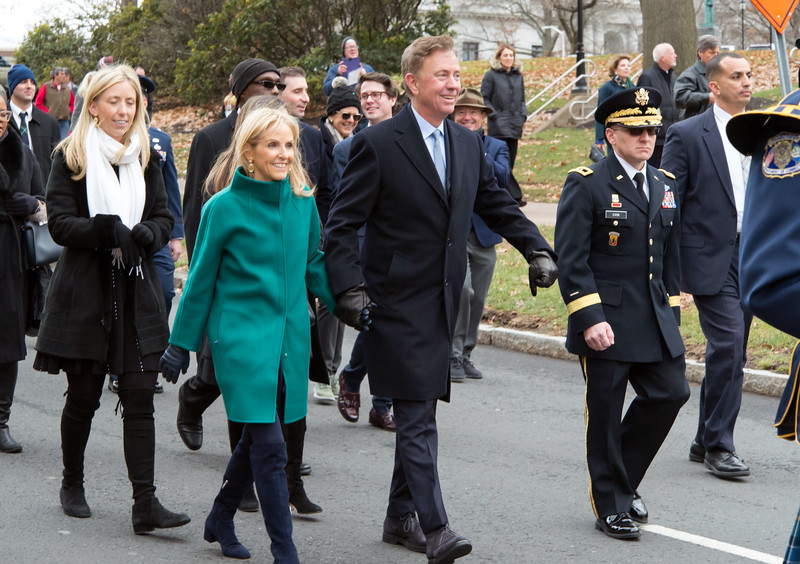 01/09/19  Wesley Bunnell | Staff  Governor Ned Lamont and his wife Ann Lamont walk side by side during his inauguration parade.
