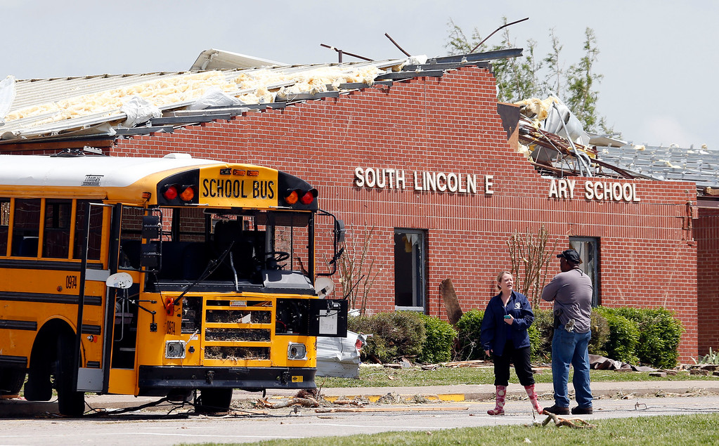 . Workers view damage at South Lincoln Elementary School on Tuesday, April 29, 2014, after storms came through Monday in Fayetteville, Tenn.  (AP Photo/Mark Humphrey)