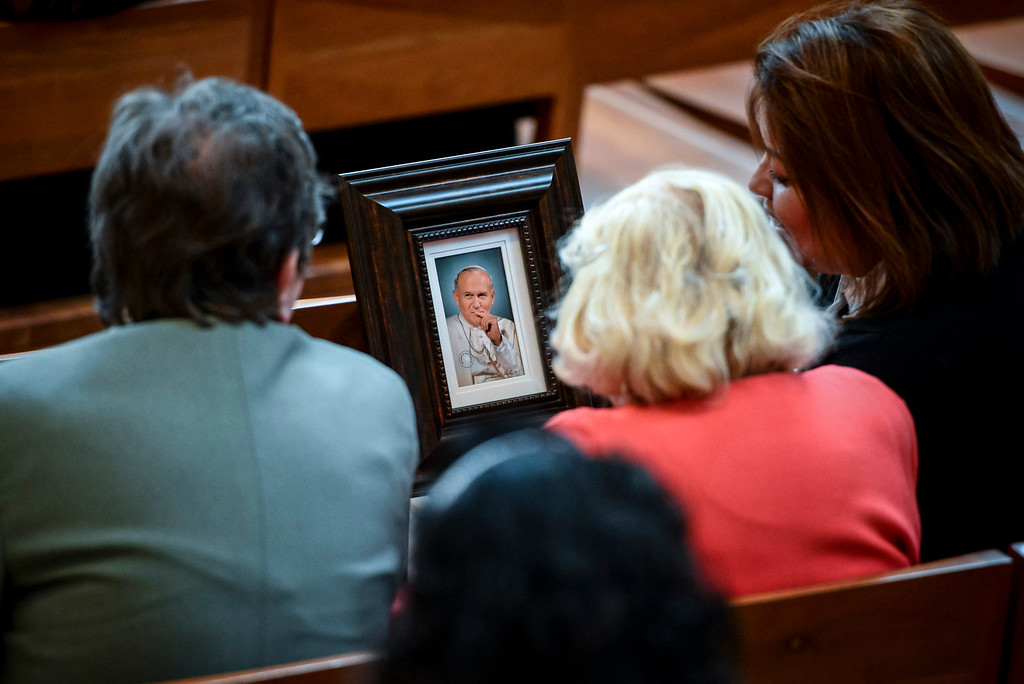 . Attendees show a signed portrait of Saint John Paul II at a Mass of Thanksgiving in honor of the canonization of Saint John XXIII and Saint John Paul II at Our Lady of the Angels Sunday, April 27, 2014.   (Photo by David Crane/Los Angeles Daily News)