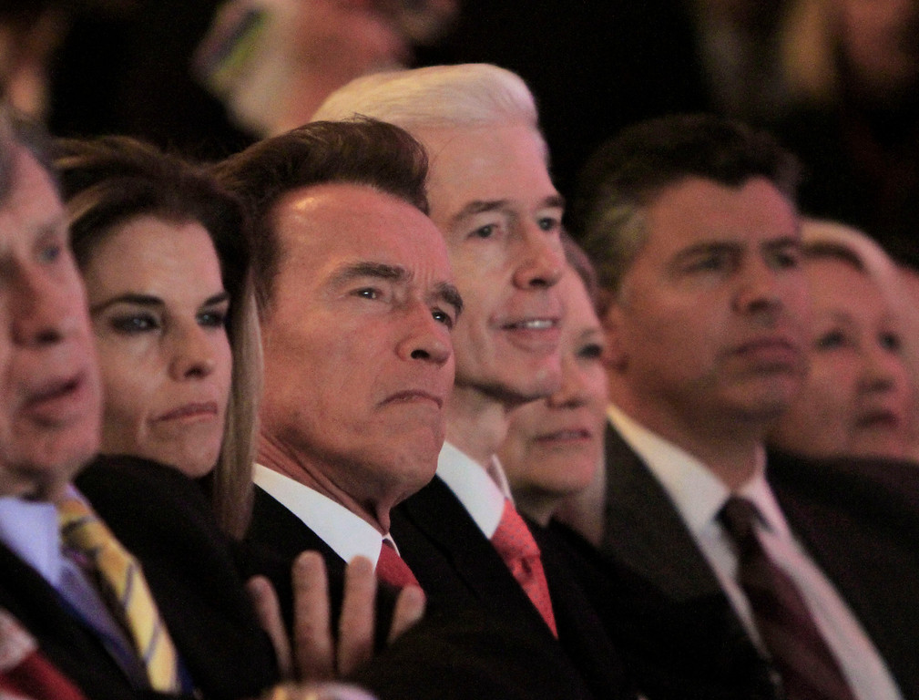 . Outgoing California Gov. Arnold Schwarzenegger second from left, and the man he replaced, former Gov. Gray Davis, third from left, listen as Gov. Jerry Brown makes remarks after he was sworn-in as the 39th Governor of California during ceremonies in Sacramento, Calif. Monday, Jan. 3, 2011.  Also seen are Schwarzenegger\'s wife, Maria Shriver, left, and former Lt. Gov. Abel Maldonado, right. (AP Photo/Rich Pedroncelli)