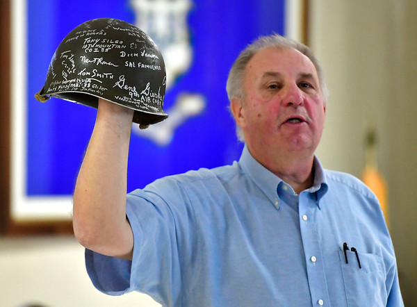 12/7/2019 Mike Orazzi | StaffrNeal Supranovich hold a WWII helmet signed by Bristol veterans at the Bristol American Legion Seicheprey Post 2 on Saturday morning for the Pearl Harbor Day ceremony.