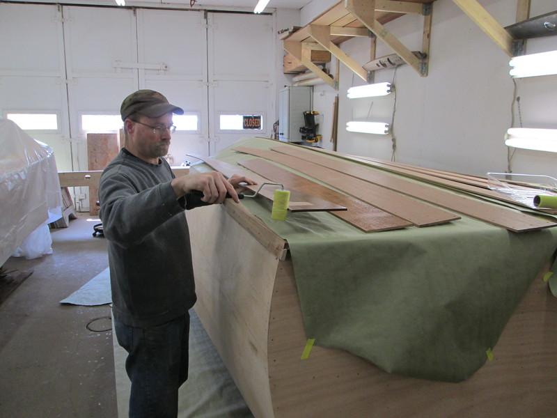 Applying epoxy to the new planks.