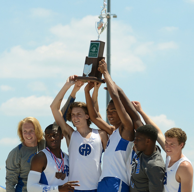 . Maribeth Joeright/MJoeright@News-Herald.com <p> The Gilmour boys track team show off their trophy after winning the runner-up team title in Division III during the state final track and field championships in Columbus, June 7, 2014.
