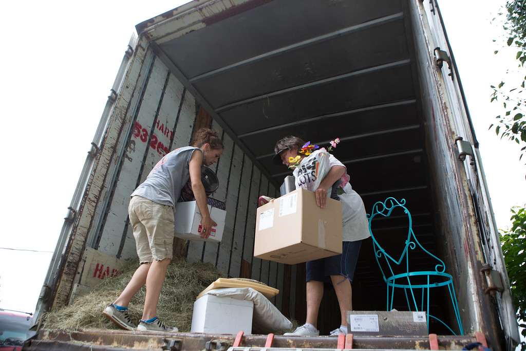 . April Jones and Jodi Boyd load items into a semi trailer out of Boyd\'s home in the Richmond Rd. bottoms area of Texarkana, Texas. Monday, May 25, 2015, in preparation of the Red River flooding. A neighbor brought a semi trailer to the elderly widow\'s home so valuables could be moved to a safer area. All along the Red, residents are working together to help neighbors and family move what they can to higher ground. Over the coming days the Red River is expected to crest near the same level it did in 1990, the last time there was large-scale damage here from the Red topping its banks. (Evan Lewis/The Texarkana Gazette via AP)