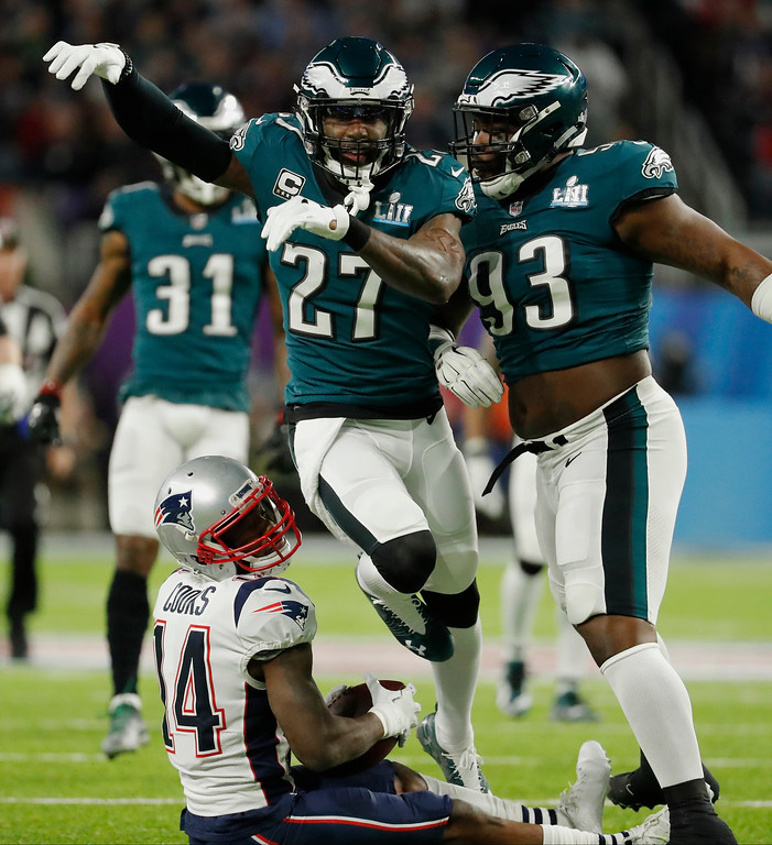 . Philadelphia Eagles strong safety Malcolm Jenkins (27), celebrates with defensive tackle Timmy Jernigan (93, after tackling New England Patriots wide receiver Brandin Cooks (14), during the first half of the NFL Super Bowl 52 football game, Sunday, Feb. 4, 2018, in Minneapolis. (AP Photo/Charlie Neibergall)