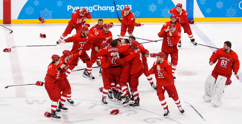 . Olympic athletes from Russia celebrate after winning the men\'s gold medal hockey game against Germany, 4-3, in overtime at the 2018 Winter Olympics, Sunday, Feb. 25, 2018, in Gangneung, South Korea. (AP Photo/Jae C. Hong)