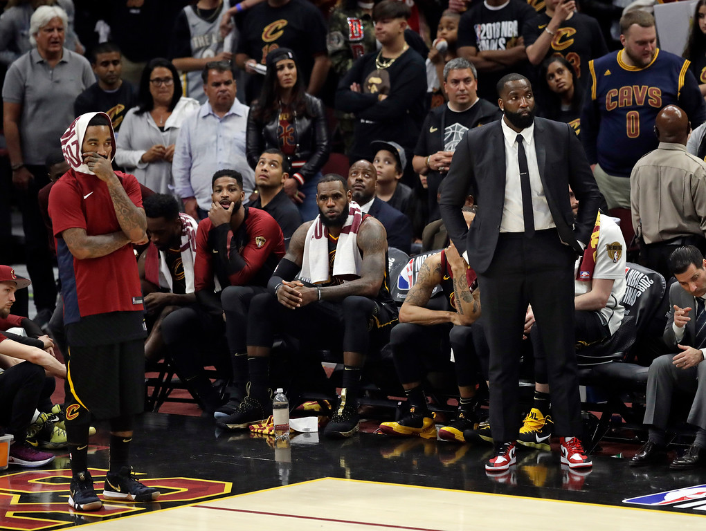 . The Cleveland Cavaliers watch late in the second half of Game 4 of basketball\'s NBA Finals against the Golden State Warriors, Friday, June 8, 2018, in Cleveland. The Warriors defeated the Cavaliers 108-85. (AP Photo/Tony Dejak)