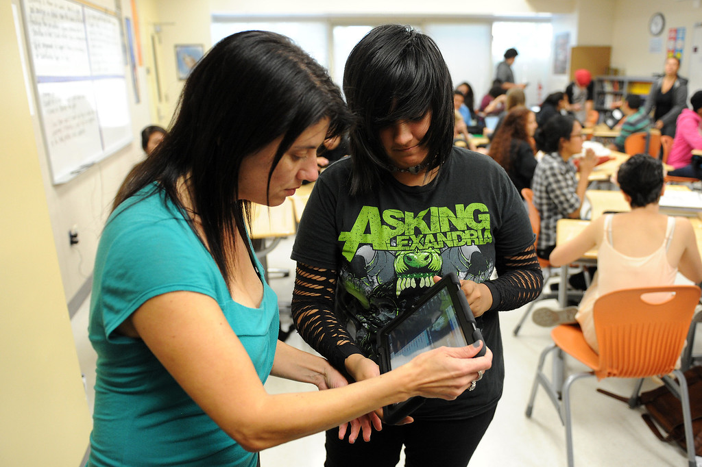 . Valley Academy of Arts & Sciences student Carolyn Alvarez shows English teacher Jenn Wolfe her blog page she made on an iPad, Tuesday, October 15, 2013. The Valley Academy is one of two LAUSD schools in the San Fernando Valley that are participating in the rollout of the iPad plan. (Photo by Michael Owen Baker/L.A. Daily News)