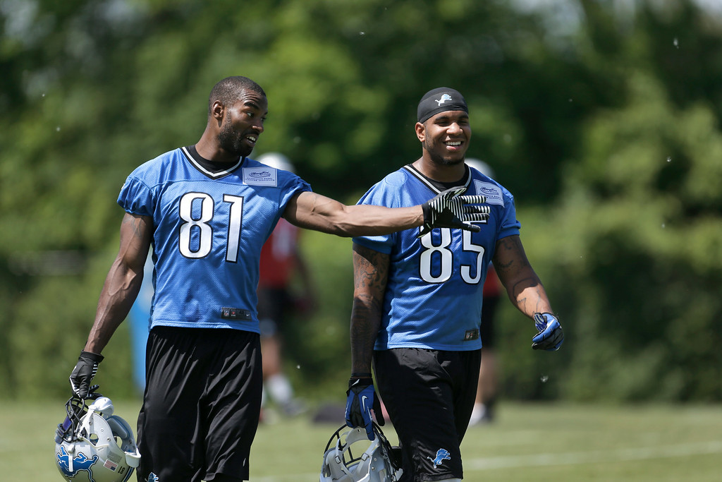 . Detroit Lions wide receiver Calvin Johnson (81) laughs with tight end Eric Ebron (85) after NFL football practice in Allen Park, MIch., Tuesday, June 3, 2014. (AP Photo/Paul Sancya)