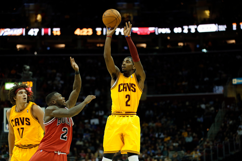 . Cleveland Cavaliers\' Kyrie Irving, right, shoots over Chicago Bulls\' Nate Robinson in an NBA basketball game Friday, Nov. 2, 2012, in Cleveland. (AP Photo/Mark Duncan)
