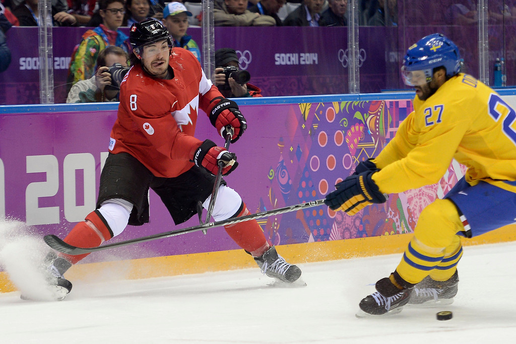 . Drew Doughty (8) of Canada passes the puck as Johnny Oduya (27) of Sweden defends during the first period of the men\'s ice hockey gold medal game. Sochi 2014 Winter Olympics on Sunday, February 23, 2014 at Bolshoy Ice Arena. (Photo by AAron Ontiveroz/ The Denver Post)
