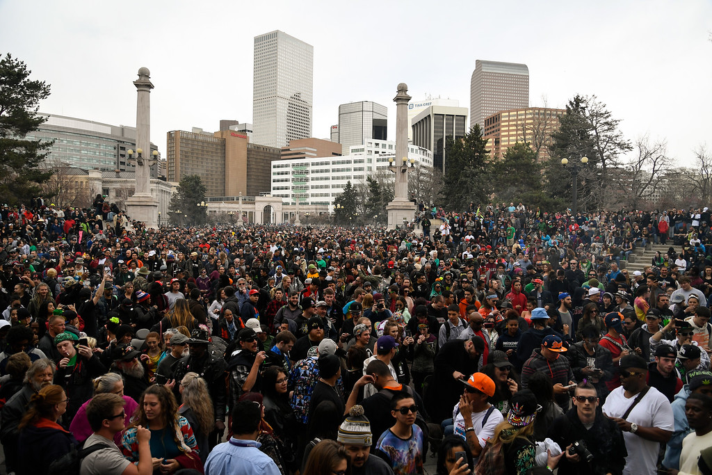 . DENVER, CO - APRIL 20: A big crowd gathers at Civic Center and light up during 4-20 celebration April 20, 2016 in Denver. (Photo By John Leyba/The Denver Post)