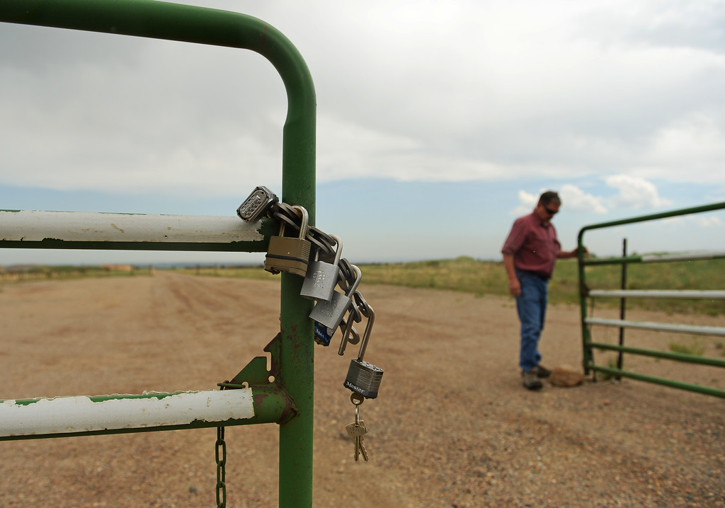 . Scott Surovchak, U.S. Department of Energy Site Manager for Rocky Flats, opens the gate to Rocky Flats that was once the site of the a nuclear weapons production facility, May 29, 2014.  (Photo by RJ Sangosti/The Denver Post)