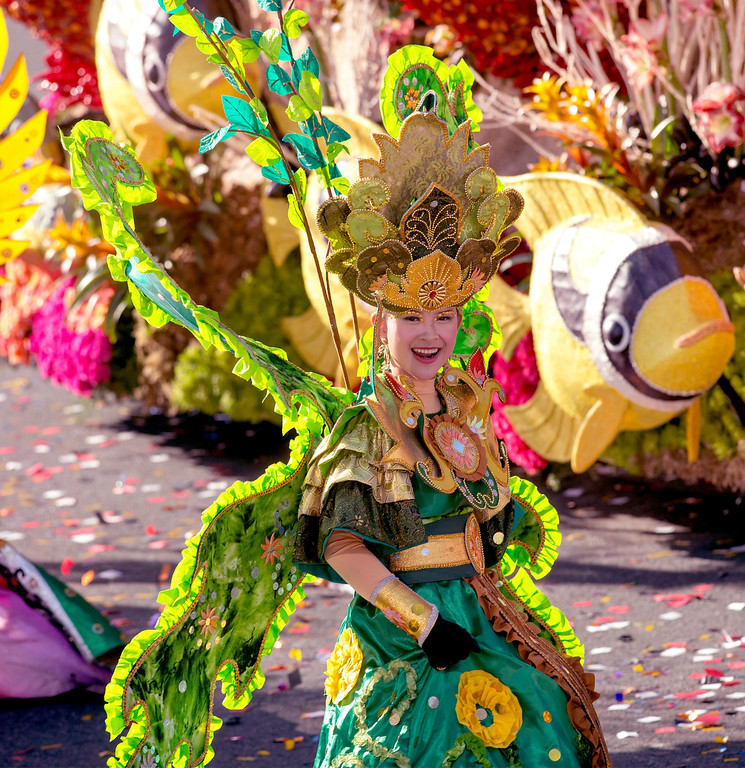 ". A dancer with Ministry of Tourism and Creative Economy, Republic of Indonesia ""Wonderful Indonesia\"" float during 2014 Rose Parade in Pasadena, Calif. on January 1, 2014. This float won Directors\' award for outstanding artistic merit in design and floral presentation. (Staff photo by Leo Jarzomb/ Pasadena Star-News)"