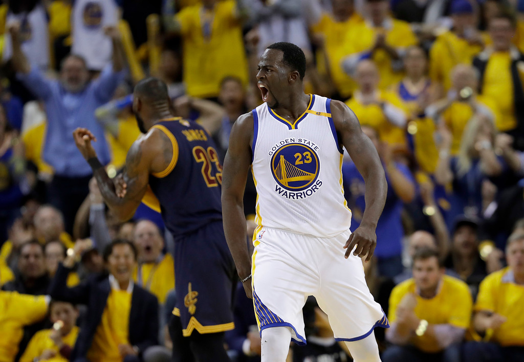 . Golden State Warriors forward Draymond Green, foreground, reacts in front of Cleveland Cavaliers forward LeBron James during the second half of Game 1 of basketball\'s NBA Finals in Oakland, Calif., Thursday, June 1, 2017. (AP Photo/Marcio Jose Sanchez)