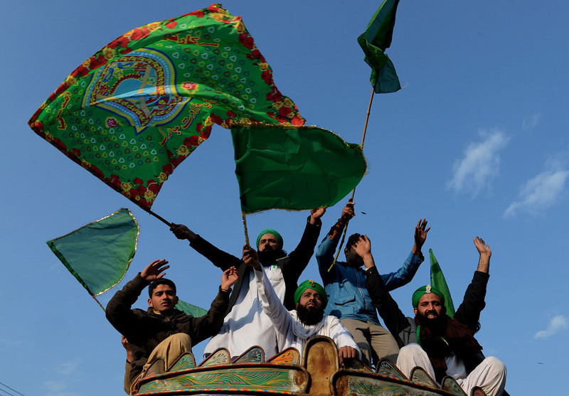 . Pakistani Muslims wave religious flags during celebrations marking Eid Milad-un-Nabi, the birthday of Prophet Mohammed, in Lahore on January 14, 2014. Muslims across the world celebrate the birth of the Prophet Mohammed on 12 Rabil ul Awal, a month of the Muslim calendar. (Arif Ali/AFP/Getty Images)