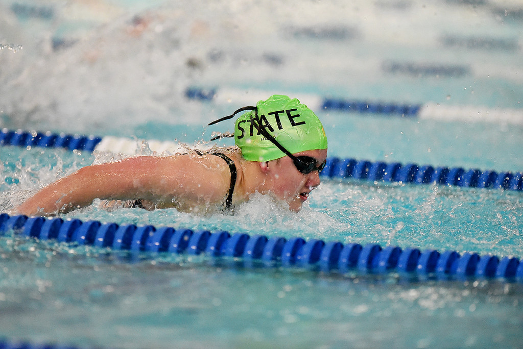 . Fossil Ridge\'s Coleen Gillilan won the 100 Yard Butterfly during the girls 5A State Swim meet held at Edora Pool and Ice Center on Saturday. (Photo by Kira Horvath/ The Denver Post)