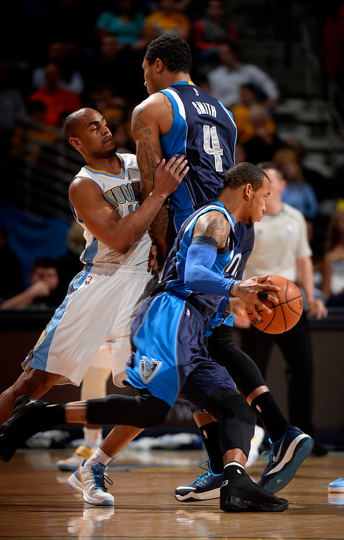 . DENVER, CO - JANUARY 14: Dallas Mavericks guard Monta Ellis (11) makes a move to the basket as Denver Nuggets guard Arron Afflalo (10) runs in to Dallas Mavericks forward Greg Smith (4) during the first quarter January 14, 2015 at Pepsi Center. (Photo By John Leyba/The Denver Post)