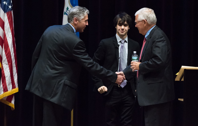 11/2/17  Wesley Bunnell | Staff  The Berlin High School Speech and Debate Club hosted a mayoral debate on Thursday night in the school's auditorium. Republican incumbent Mark Kaczynski, L, and Democratic challenger Richard Paskiewicz shake hands in front of the moderator and BHS Junior and President of the schools speech and debate club Christian Damiana.