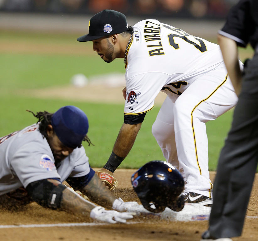 . American League�s Prince Fielder, of the Detroit Tigers, is safe at third as National League�s Pedro Alvarez, of the Pittsburgh Pirates, attempts to make the tag on a triple by Fielder during the ninth inning of the MLB All-Star baseball game, on Tuesday, July 16, 2013, in New York. (AP Photo/Kathy Willens)