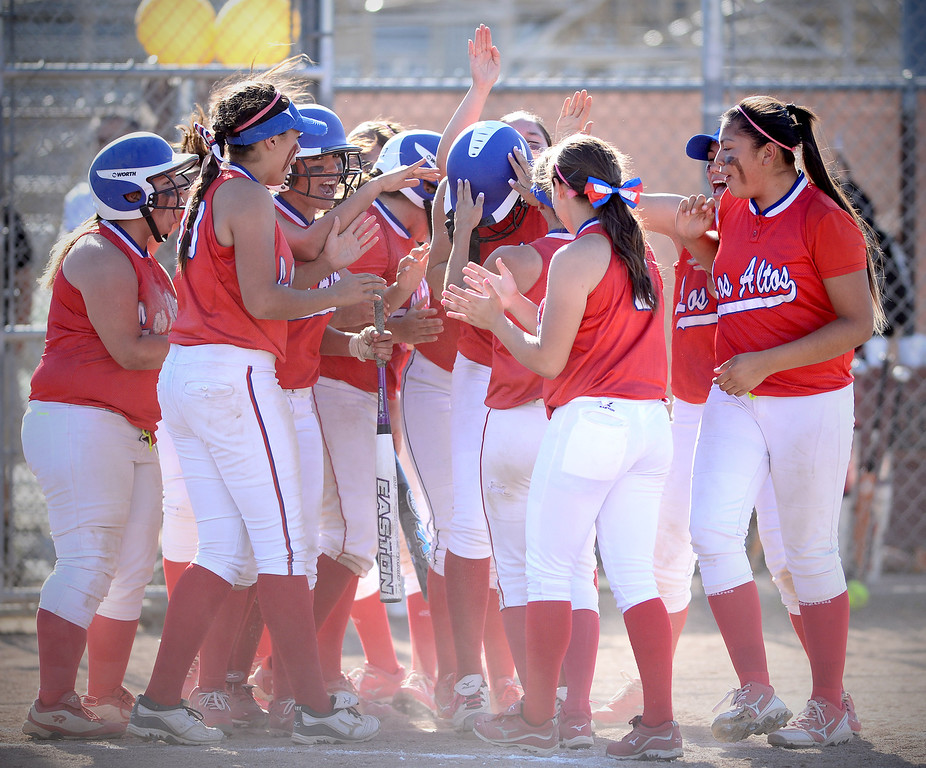 . Los Altos celebrates tying up in the 6th after pitcher Celeste Wood\'s home run Thursday, May 15, 2014 at West Covina High School. Los Altos beat West Covina 4-3. (Photo by Sarah Reingewirtz/Pasadena Star-News)