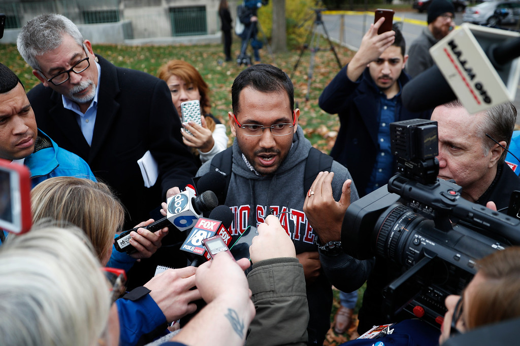 . Angshuman Kapil, a graduate student at Ohio State University, speaks to members of the media as police investigate an attack on campus, Monday, Nov. 28, 2016, in Columbus, Ohio. Kapil was outside the building when a car barreled onto the sidewalk. �It just hit everybody who was in front,� he said. �After that everybody was shouting run, run, run.� (AP Photo/John Minchillo)