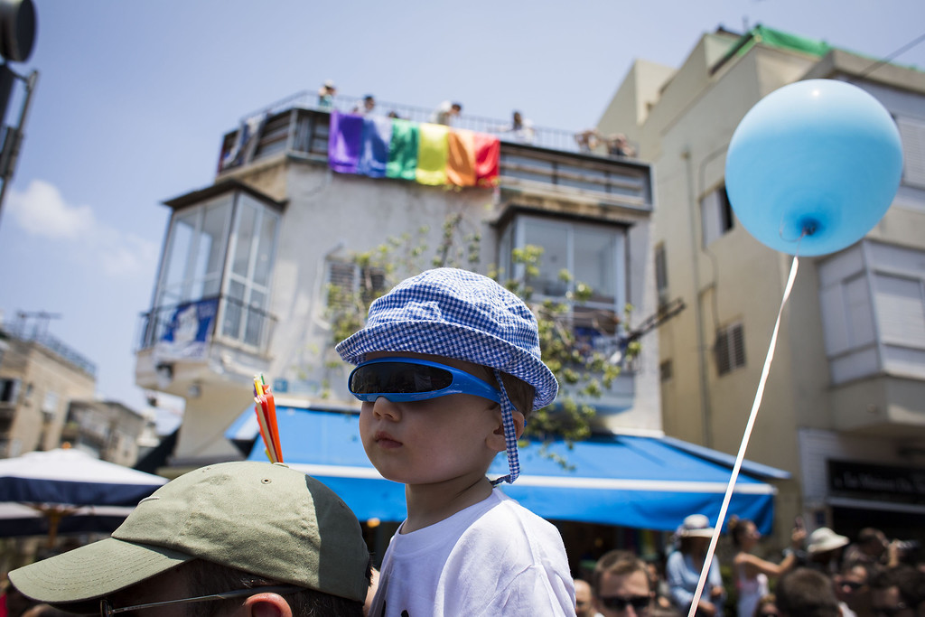 . People take part in the annual Tel Aviv Gay Pride parade on June 13, 2014 in Tel Aviv, Israel. Thousands of people gathered in Tel Aviv for the parade, which attracts visitors from all over the world.  (Photo by Ilia Yefimovich/Getty Images)