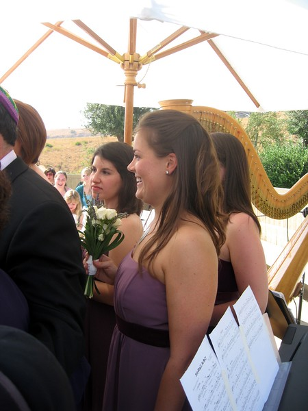 Bridesmaids Vicki (l) and Sarah watch the ceremony