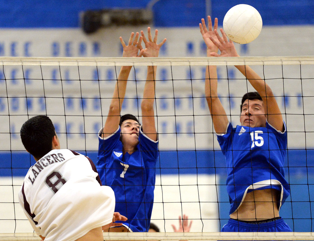 . El Rancho\'s Anthony Arauz-Diaz (#7) and Bryan Rojas (#15) block a shot from Bell Gardens\' Charlie Hernandez (#8) in their non-league game at El Rancho High School in Pico Rivera on Friday March 28, 2014. Bell Gardens defeated El Rancho 3-2 games. (Staff Photo by Keith Durflinger/Whittier Daily News)