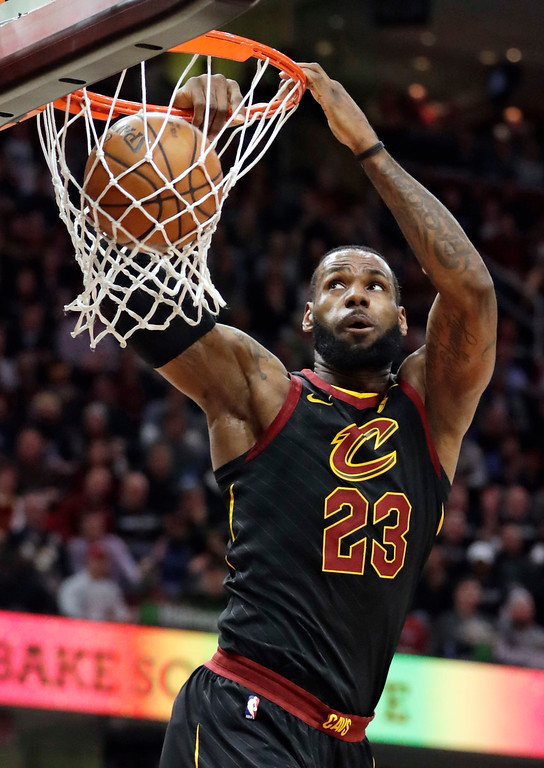 . Cleveland Cavaliers\' LeBron James dunks against the Golden State Warriors in the first half of an NBA basketball game, Monday, Jan. 15, 2018, in Cleveland. (AP Photo/Tony Dejak)