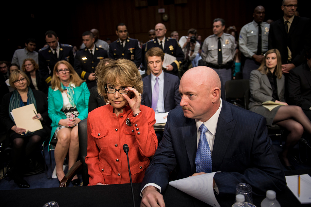 . Retired Astronaut Mark Kelly(R), husband of former Arizona Rep. Gabrielle Giffords(L), before she makes a statement during a hearing of the Senate Judiciary Committee on Capitol Hill January 30, 2013 in Washington, DC. The committee held the hearing with retired Astronaut Mark Kelly, husband of former Rep. Gabrielle Giffords, Wayne LaPierre, Chief Executive Officer of the National Rifle Association, and others to testify about solutions to gun violence in the United States.  BRENDAN SMIALOWSKI/AFP/Getty Images