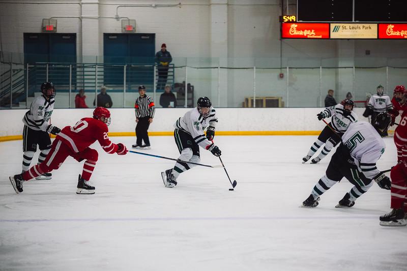 Holy Family Boys Varsity Hockey vs. Benilde-St. Margaret's, 12/26/19: Grant Limke '21 (9)