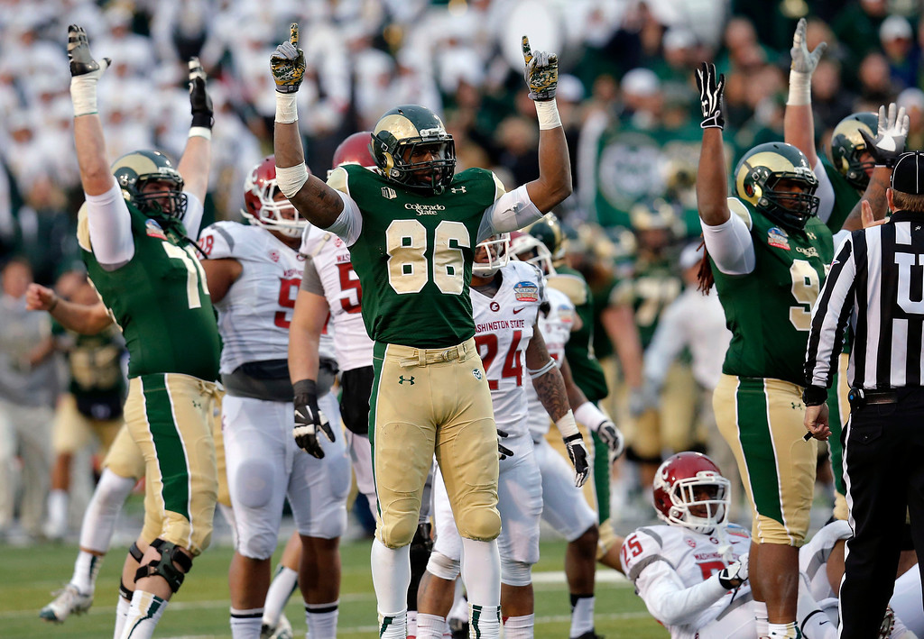 . Colorado State tight end Kivon Cartwright (86) celebrates with teammates as the game winning field goal is made against Washington State during the second half of the NCAA New Mexico Bowl college football game, Saturday, Dec. 21, 2013, in Albuquerque, N.M. Colorado State won 48-45.(AP Photo/Matt York)