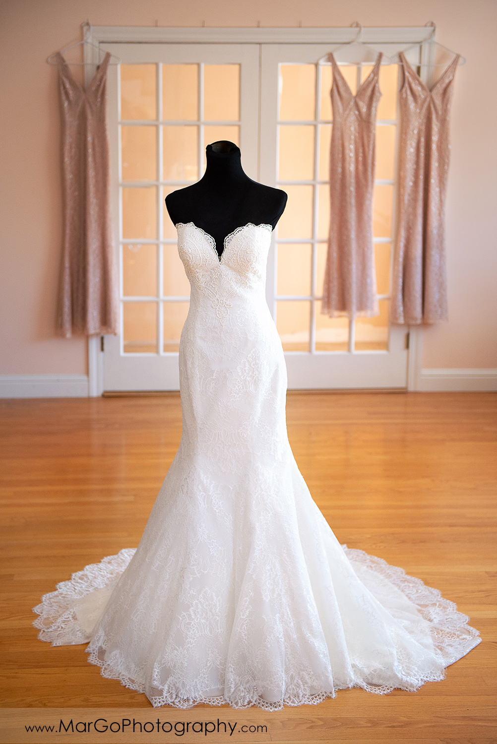 wedding dress with bridesmaids dresses in the background