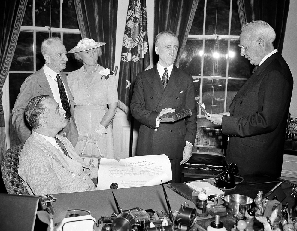 . Former Senator James F. Byrnes, of South Carolina, takes the oath as an associate justice of the United States Supreme Court, as Chief Justice Richard Whaley, of the U.S. Court of Claims, officiates at the White House ceremony in Washington on July 8, 1941. From left to right are: President Franklin D. Roosevelt (seated); Senator Carter Glass, of Virginia; Mrs. Byrnes; the new associate justice; and Justice Whaley. (AP Photo)