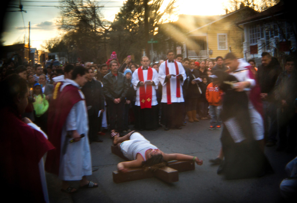 . Roman Catholics act out the Crucifixion in Roland Doe\'s boyhood neighborhood during a Via Crucis parade organized by the boy\'s old church, Saint James Parish, in Prince George\'s County, Maryland, USA, 29 March 2013. In 1949, a Saint James priest named Father Albert Hughes first proclaimed Roland\'s need of an exorcism. Roland, who was then Lutheran, converted to Catholicism and joined Saint James Parish.  All of the pictures for this essay were made with specialty lenses attached to a 35mm camera. EPA/JIM LO SCALZO