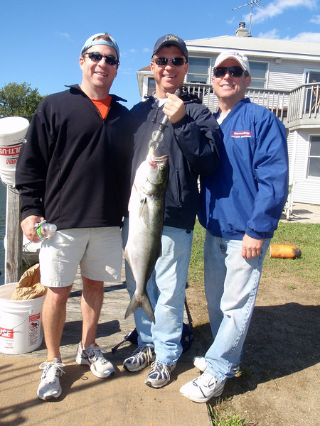 9/25/2009  I fished today with Jeff Schumacher, his brother Craig and buddy Jim (center, left right).   We targeted striped bass but as was the case yesterday the bass did not cooperate. It was bluefish only and the guys kept one for the table.  A nice day on the water even if the fishing was below par.  Another good day on the water.  Captain Al Lorenzetti