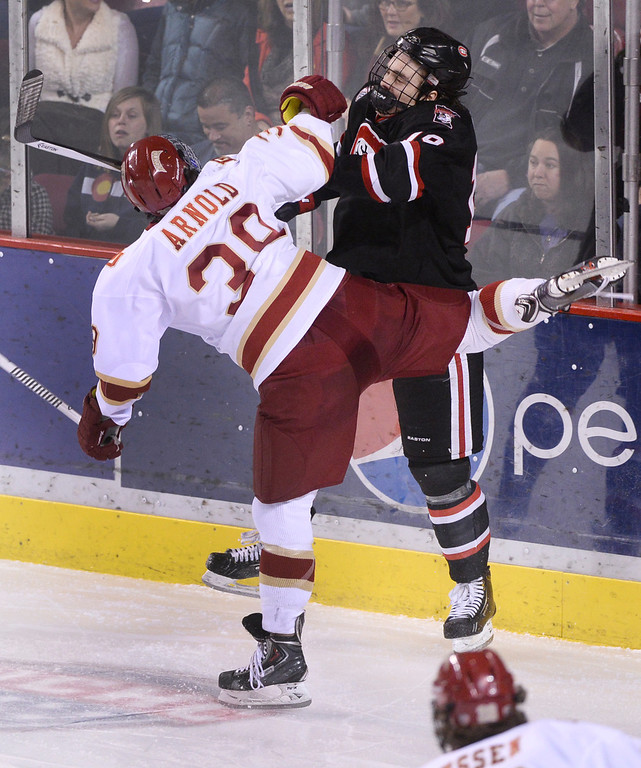 . DENVER, CO. - JANUARY 10: Denver wing Grant Arnold (39) collided with Huskies\' defenseman Ben Storm (19) in the second period. The University of Denver hockey team hosted St. Cloud State at Magness Arena Friday night, January 10, 2014. Photo By Karl Gehring/The Denver Post