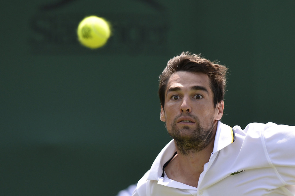. France\'s Jeremy Chardy eyes the ball as he returns against US player Ryan Harrison during their men\'s first round match on day two of the 2013 Wimbledon Championships tennis tournament at the All England Club in Wimbledon, southwest London, on June 25, 2013. Chardy won 7-6, 6-4, 7-5, 6-2.  ADRIAN DENNIS/AFP/Getty Images