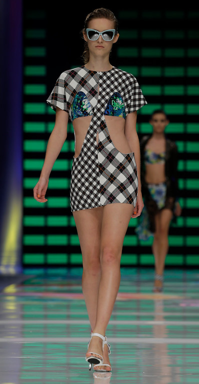 . A model wears a creation for Just Cavalli women\'s Spring-Summer 2014 collection, part of the Milan Fashion Week, unveiled in Milan, Italy, Thursday, Sept. 19, 2013. (AP Photo/Luca Bruno)