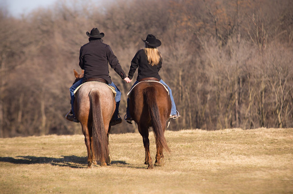 Couple  horseback riding at Perks Ranch during winter engagement photos in Rockford, IL